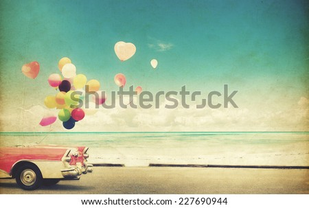 Vintage paper card car with heart balloon on beach blue sky concept of love in summer and wedding honeymoon - stock photo