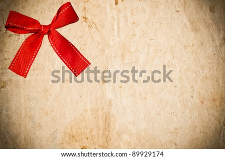 Vintage paper card with red bow - stock photo