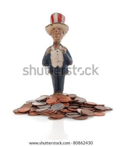 Vintage paper mache Uncle Sam with coins - stock photo