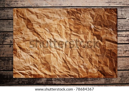 Vintage paper on th classic wood texture background. - stock photo