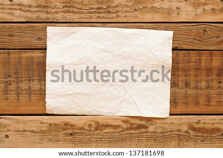 vintage paper on wood wall - stock photo