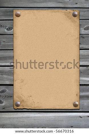 vintage paper over pannel wood background - stock photo