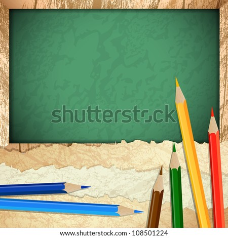 Vintage paper pieces with multicolored pencils over blackboard background