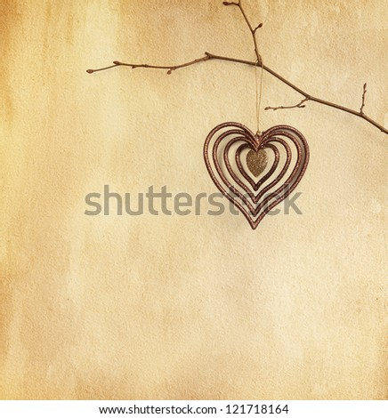 vintage paper  with  heart   hanging  on  branch. - stock photo