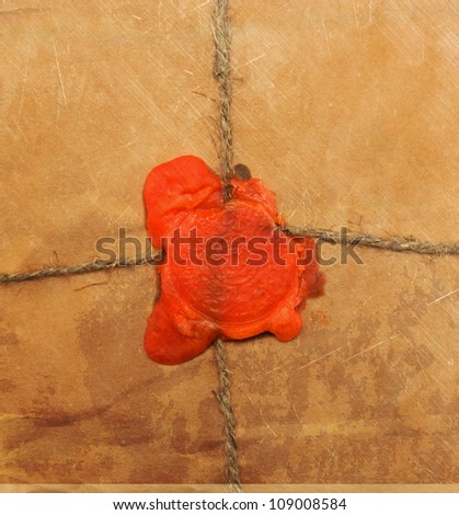 Vintage parcel wrapped with brown kraft paper - stock photo