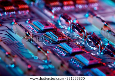 Vintage PCB with dark blue and red light effects. Shallow DOF. - stock photo