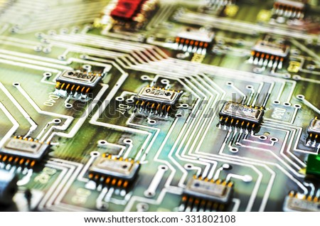 Vintage PCB with digital effects applied. Shallow DOF. - stock photo