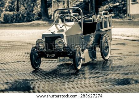 Vintage pedal toy car - stock photo