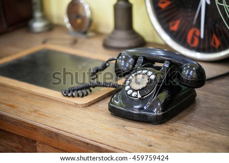 vintage phone on table - stock photo