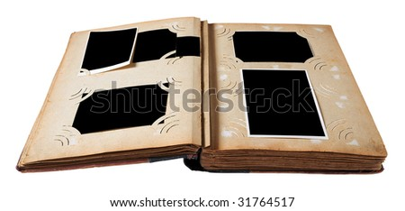 Vintage photo album with blank photos isolated on white background with clipping path
