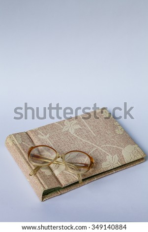 Vintage photo album with old granny glasses
