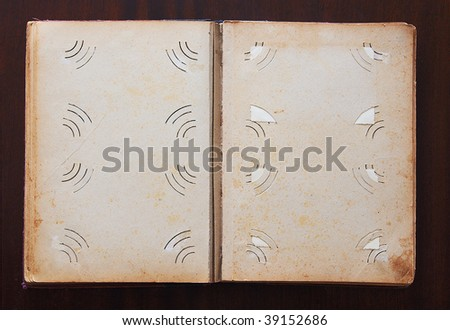 Vintage photo album without photos on old wooden texture - stock photo
