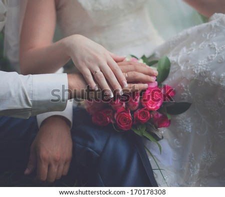 Vintage photo bride and groom, hands, pink gentle wedding bouquet, country, rustic - style - stock photo