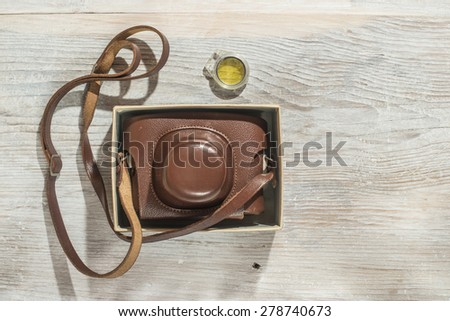 Vintage photo camera on white wooden background