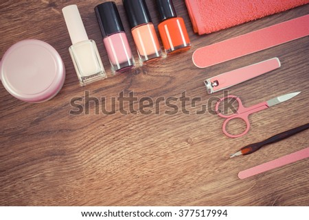 Set Colorful Cosmetics On Pink Wooden Stock Photo
