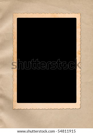 Vintage photo frame on ancient paper - stock photo