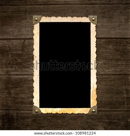 vintage photo frame on wooden board background texture - stock photo