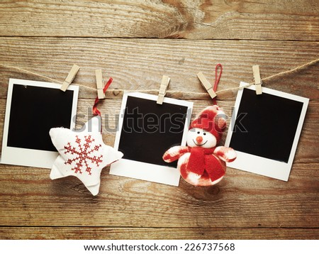 Vintage photo frames decorated for Christmas on the wooden board background with space for your text - stock photo