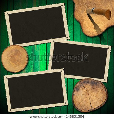 Vintage Photo Frames on Wood Green Wall / Three aged photo frames on wooden green background with sections of the trunk and folding knife  - stock photo