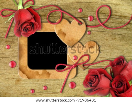 Vintage photo frames, red roses and heart on an old, cracked background