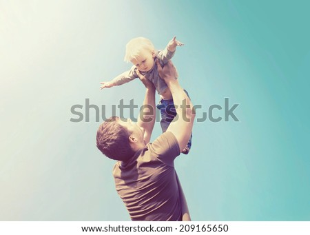 Vintage photo happy father and son having fun - stock photo
