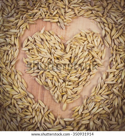 Vintage photo, Heart shaped organic oat grains as background, healthy food and nutrition, symbol of love