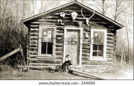 Vintage Photo of a Boy And Dog In Front Of Shack - stock photo