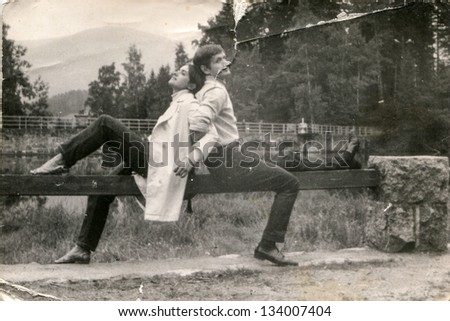 Vintage photo of a couple outdoor (seventies) - stock photo