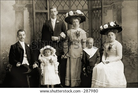 Vintage photo of a Family Portrait In Sunday Best - stock photo
