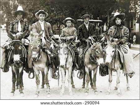 Vintage photo of a Group of Guys On Mules - stock photo