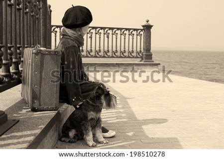 Vintage photo of a little girl and his dog  - stock photo