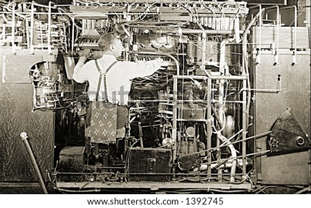 Vintage photo of a Man Working On Complex Machine - stock photo