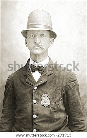 Vintage photo of a Policeman In Uniform - stock photo