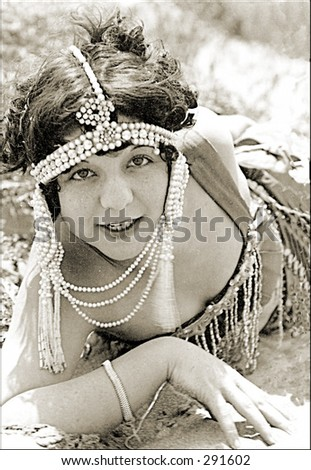Vintage photo of a Woman Wearing Flapper Costume With Pearls - stock photo