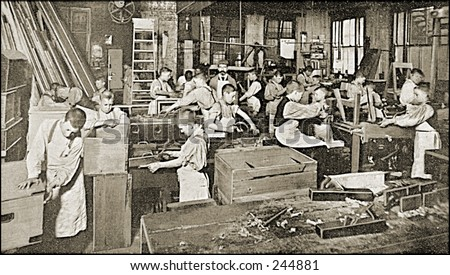 Vintage Photo of a Workshop With Young Boys Working - stock photo