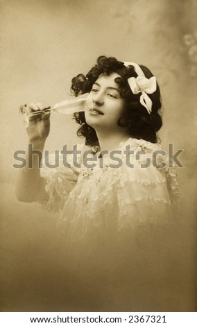 Vintage photo of a young woman drinking from a champaign glass - stock photo