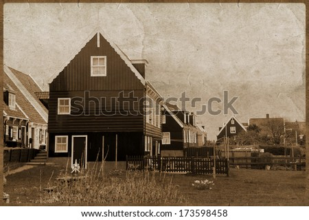 Vintage photo of aged buildings in Amsterdam country