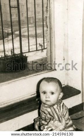 Vintage photo of baby girl (early eighties) - stock photo