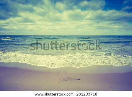 Vintage photo of beautiful beach landscape with cloudy sky and sea with waves. Baltic sea coast near Gdansk in Poland.  - stock photo