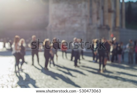 Vintage photo of Blurred crowd of walking people in the city with buildings in the background. Rome city center. Italy.