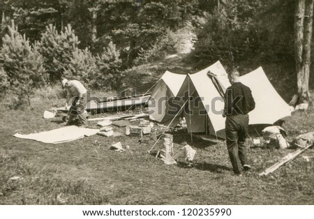 Vintage photo of boys camping (sixties) - stock photo