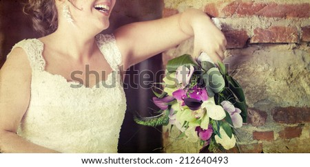 Vintage photo of bride holding wedding bouquet