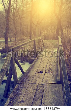 Vintage photo of bridge in the forest - stock photo