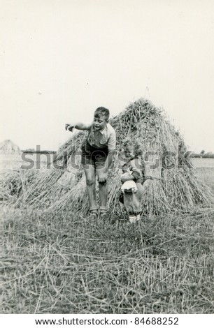 Vintage photo of brother and sister (fifties) - stock photo