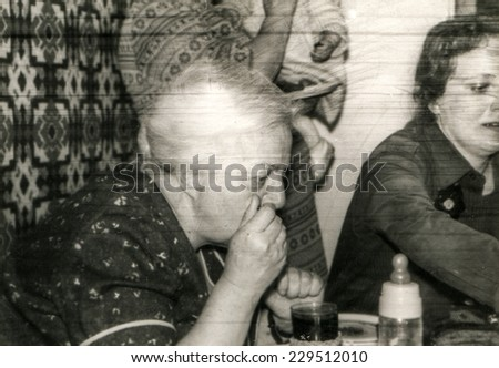 Vintage photo of child anniversary - mother and grandmother at table, 1982 - stock photo