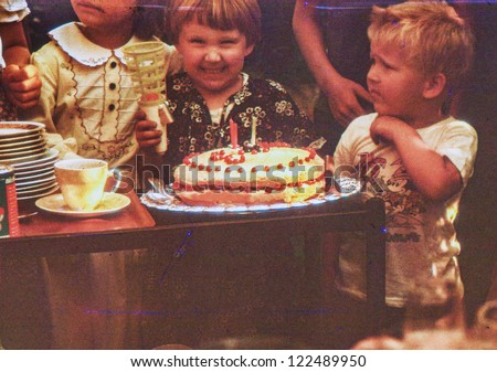 Vintage photo of child birthday party (early eighties) - stock photo