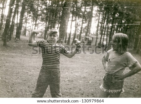 Vintage photo of children (early eighties) - stock photo