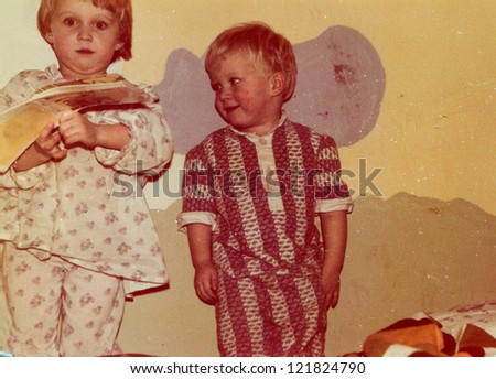 Vintage photo of children in pajamas (early eighties) - stock photo