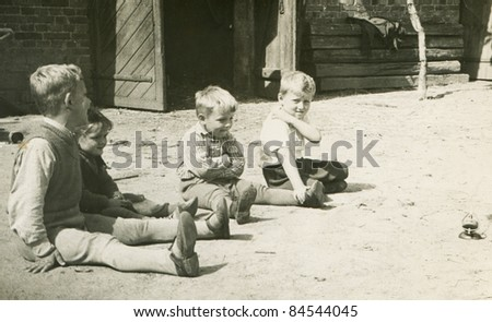 Vintage photo of children playing outdoor (fifties) - stock photo