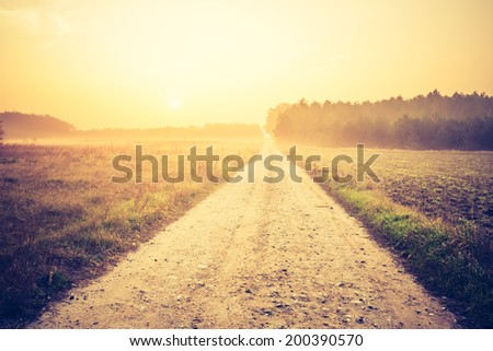 vintage photo of country road - stock photo
